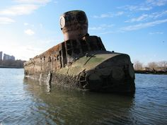 """The Quester 1 - the """"yellow submarine"""" privately built to salvage the Andrea Doria. It only made it as far as Coney Island creek, where its remains rest to this day."""