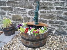 Bucket planter with rustic water feature, gorgeous!