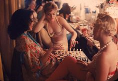 Showgirls playing chess between shows at Latin Quarter Nightclub.  Photograph by Gordon Parks, 1958