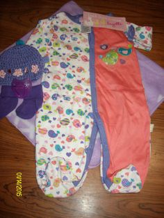 Swaddled Baby Girls Swaddled Lavender & Coral Birdy Pajama Baby Diaper Cake w/Violet Blanket LBB06, You will receive 1-Micro Fiber Receiving Blanket, 1-Full Body Pajama, 1-Handmade Crochet Beanie,1 Pacifier,1 Pair of Socks & 12 Use-able Diapers.$25.00 free ship