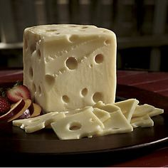 """Chalet Swiss Cheese from The Wisconsin Cheeseman: A second-place winner in the 2012 World Cheese Championships, this semi-soft """"baby""""with small eyes is less aged and less nutty than regular Swiss. www.wisconsincheeseman.com"""