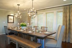 Fascinating Orb Chandelier For Amazing Interior: Terrific Two Orb Chandeliers Addition For Transitional Style Dining Room With Wooden Table And Bench Combined With Classic Chair With Beads ~ SFXit Design Dining Room Inspiration