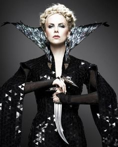 charlize theron as the queen in the new snow white reboot. she looks delightfully evil.
