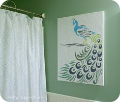 Wow, All done w paper. I could see this done w pieces fm old glossy mags or scrapbook papers. See thriftyinspirations.net peacock Bathroom