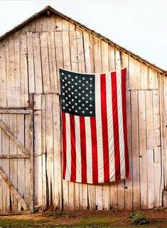 The red white and blue...proudly displayed on faded od barn......