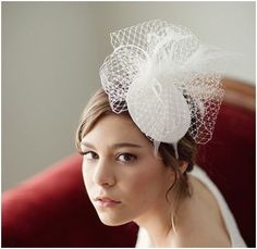 Bridal Hat, birdcage veil fascinator, bridal mini hat, SORIAH. Bridal hat made from a Dupioni silk wrapped buckram hat base, Russian veiling, goose, ostrich, and rooster feathers. This piece attaches to the hair with a silver alligator clip for secure hold and easy placement!