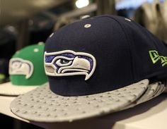 Marshawn Lynch designs New Era Seahawks caps with sales to benefit his Fam 1st Family Foundation