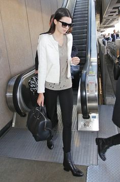 Good travel look, stretch trousers (good for long haul) loose T crisp jacket and sensible flat ankle boots plus bag to hold all onboard essentials.