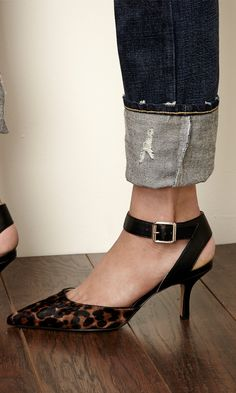 Pointed toe d'orsay mid heel in genuine suede with adjustable ankle strap and buckle detail.