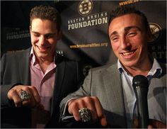 Tyler Seguin and Brad Marchand show off their rings.