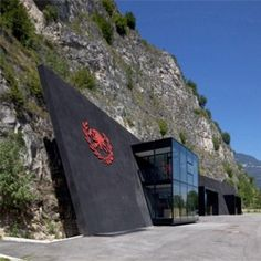 This is the coolest fire station I've ever seen.    In The Rock, a  fire station in a cave in Magreid, Italy by Berg Meister Wolf.