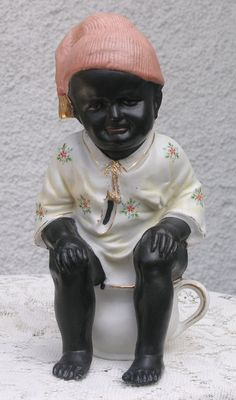 Rare Large-size German All-bisque Figure of Black Character Child    $595