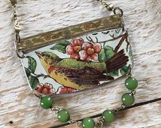 Excited to share this item from my shop: Vintage bird tin necklace Deanna Todd Tassel Jewelry, Metal Jewelry, Jewelry Shop, Custom Jewelry, Handmade Jewelry, Jewelry Making, Silver Jewelry, Silver Ring, Silver Earrings