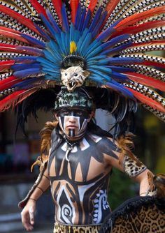A man wearing a pre-Hispanic costume performs at a tourist area of Playa del Carmen in Quintana Roo state, Mexico, during preparations for the celebration of the end of the Maya Long Count Calendar - Baktun 13 - and the beginning of a new era Native American Face Paint, Native American Indians, Aztec Costume, Arte Peculiar, Inka, Aztec Warrior, Aztec Art, Chicano Art, We Are The World