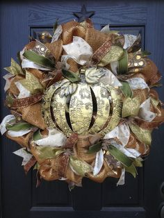 This beautiful wreath is perfect for fall! Can be purchased on our Facebook page! Www.facebook.com/GlitzyWreaths