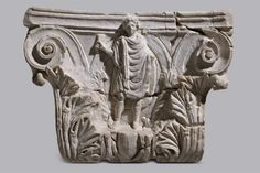 Corinthian Pilaster Capital with Relief Figure of Kabeiros Early 4th century. White marble, fine grained. Thessaloniki, Archaeological Museum