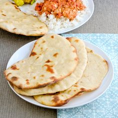 I love naan, especially with garlic.  It would be quite easy to add a little fresh sauteed garlic to the dough.