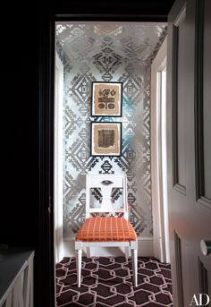 The bath's entrance is lined with a Lee Jofa wallpaper.