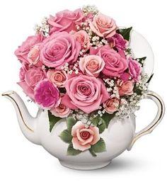 teapot flower arrangements   ... disney snowglobes along with teapot and teacup flower arrangements