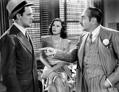GOLDEN BOY, from left William Holden, Barbara Stanwyck, Adolphe Menjou, 1939