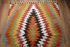 Yuner/ Vintage Kilim Rug ,Antique Kilim Rug, Decorative Rug,55 Years Old, red black and white...,color riot,43.2X30.8 inch. $289.95, via Etsy.