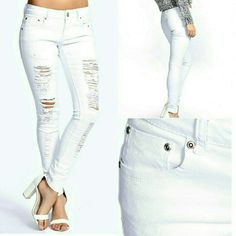 "NWT Carly White Destroyed Distressed Skinny Jeans Limited Edition! 'Denim for Dreamers'  Boohoo Blue white ladder ripped, stretch, five pocket, perfectly distressed, destroyed figure flattering low rise skinny jeans w/ 2% Elastane. Super sexy and chic! 30.5"" inseam approximate measurement.Firm price. Boohoo Jeans Skinny"