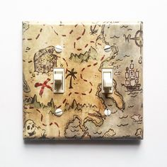 Pirate room decor -Treasure Map light Switch Cover - Pirate nursery - Pirate decor - Pirate wall decor - Decor for boys room, Pirate Bedroom by LullabyVisions on Etsy https://www.etsy.com/listing/218427501/pirate-room-decor-treasure-map-light