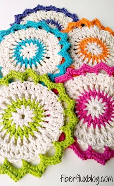 Love this adorable crochet pattern. These are so much prettier than the usual square dishcloth! #fiberflux