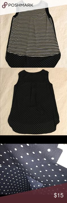 """Stylus tank top Stylus jersey striped front sleeveless top and sheer polka for back side.  Has a high low on the top at the bottom.  Third pic shows the sheerness and it isn't a thin see through like some tops.  Measurements are:  pit to pit 18 1/2"""", length front 25 1/2"""", back length 29 1/2"""".  Great as a casual top or could be dressed up with a denim jacket to blazer.  No rips tears or stains.  Sold as is due to not being brand new.  Only worn a few times.  GUC.  Comes from a smoke free…"""