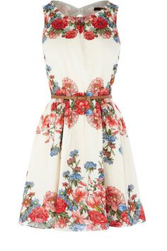 As seen in InStyle, this sleeveless dress has a placement floral print to the body and a belt fastening to the waist. With a full skirt and a rounded neckline, this piece simply zips up the back and finishes with a cut out for added detail.