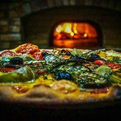 Faire et cuire une pizza au feu de bois : la meilleure recette par un professionnel