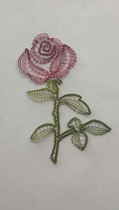 Bobbin lace rose. Pattern by Irma Pervanja, work done by Sara Rehar.
