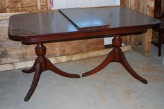 Vintage Duncan Phyfe dining room table. We had this growing up. - WM