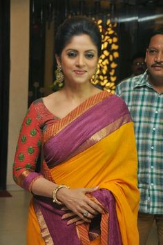 Nadhiya Latest Stills In Yellow Saree