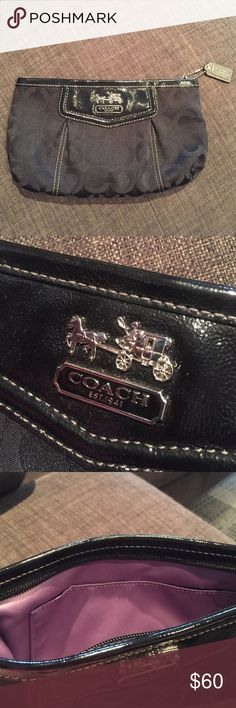 Black Coach Clutch Black clutch from Coach with lavender lining. I have literally never used it- it was a gift and I don't use clutches. Mint condition. Coach Bags Clutches & Wristlets