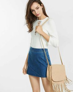 This lace-up front ribbed sweater will be a new fave.                                                                                                                                                                                 More