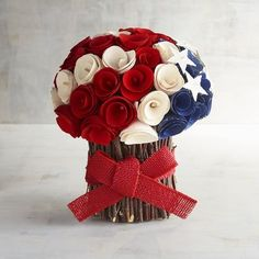 Elegant wood curls create the look of red, white and blue roses and give our handcrafted arrangement a festive yet sophisticated style. Dotted with stars, it creates a unique centerpiece for your next patriotic party.