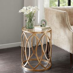 Featuring a glass table top and geometric base, this round accent table is the perfect piece for the living room or office.