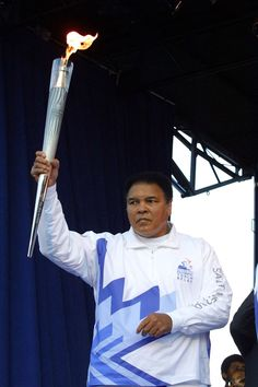 Mohammad ali carrying the olympic torch