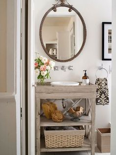 Love this powder room. Open shelves, beachy, eclectic