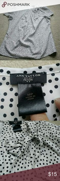 Ann Taylor polka dot top size M petite Black and white polka dot top from Ann Taylor with a bow at the neck. Half zipper in the back. Size M petite. Worn once, no signs of wear or damage. Ann Taylor Tops Blouses
