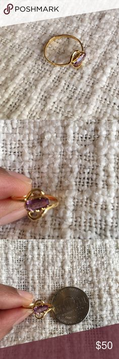 Vintage semi precious purple ring in 18k gold This is a beautiful delicate ring set in 18k gold. Gold weight is 1 gram. Ring is perfect for little finger or even as a toe ring. This ring has been in my family for three generations. I am parting with it as I wear more rose gold now. Price is fixed and not eligible for bundling. Size appears to be 3.75. See image. Jewelry Rings