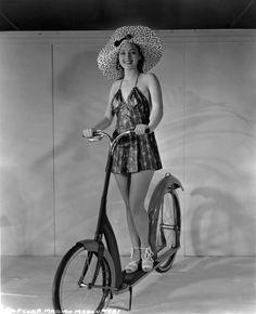 Marian Marsh rides an Ingo-bike. Marian Marsh Columbia Pictures 1935