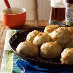 German Potato Dumplings (Kartoffel Kloesse) - flavored with nutmeg and served with browned butter sauce.