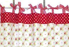 Cute, simple valance.  Hardest part would probably be getting all those bows tied evenly (so it doesn't hang crooked)