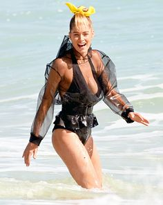 Supermodel Doutzen Kroes frolicked in the surf during a photo shoot in Miami Feb. 12.