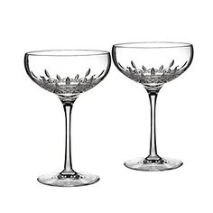 The diamond-like pattern of these Lismore Essence champagne glasses exudes glamour.