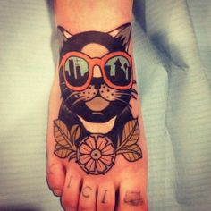 done by aivaras lee. https://www.facebook.com/totemastattoo. cat with sunglasses tattoo. reflection. skyline. foot.