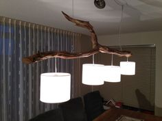 Ceiling lights with four lights, manufactured from weathered oak trunk. on Etsy, $360.00