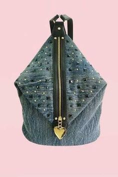 Funky, the denim rucksack by Anna Smith, a great zip at front finished with a heart logo, decorative from black and gold studs . The bag is fully lined with Anna Smith branded lining. This cool backpack has two adjustable shoulder straps. Height 18 inc My Bags, Purses And Bags, Unique Handbags, Denim Ideas, Denim Crafts, Recycle Jeans, Old Jeans, Recycled Denim, Denim Bag